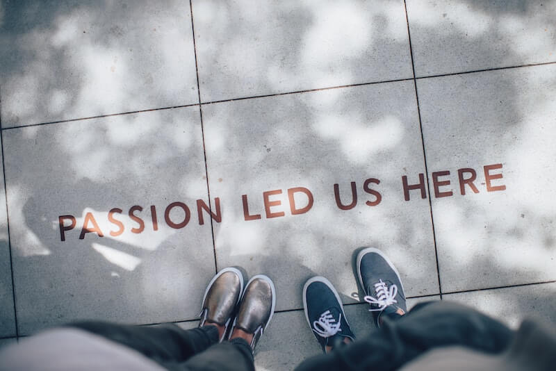 Passion led us here written on road with creators who create online courses standing by it.